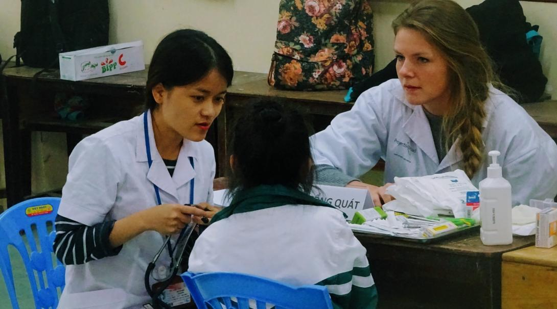 Projects Abroad interns conduct medical screening whilst on their nursing internship in Vietnam, Asia.